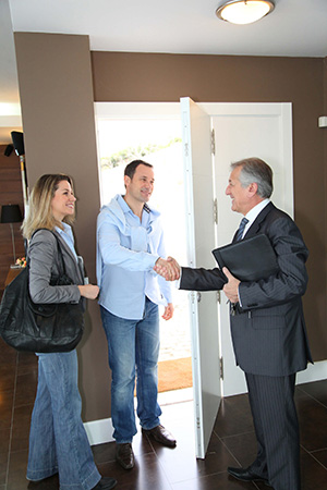 Real estate agent shaking hands with customer